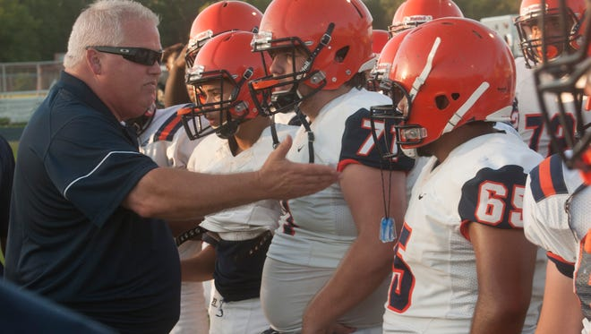 Escambia High football coach Mike Bennett readies his team for a spring jamboree in 2018. Pensacola area football programs begin the second phase of summer conditioning on Monday.