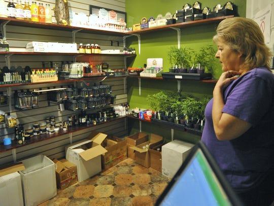 Canna Can Help's Lisa Crutchfield checks the medical