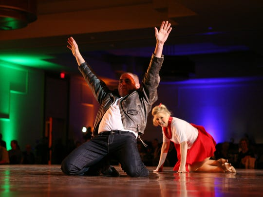Trio restaurant owner Tony Marchese, left, dances with Kelly McClean during the Dancing with the Desert Stars competition in 2013.