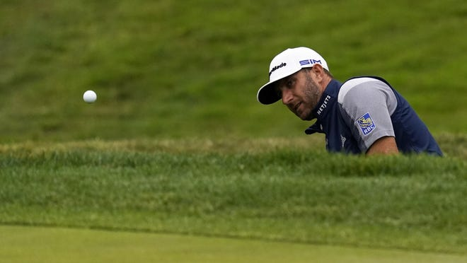 Dustin Johnson hits from the bunker on the eighth hole during the final round of the PGA Championship golf tournament at TPC Harding Park Sunday, Aug. 9, 2020, in San Francisco.