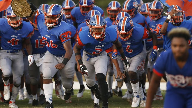 Cedar Shoals takes the field before an GHSA high school football between Cedar Shoals and Oconee County in Athens, Ga., on Friday Sept. 11, 2020.