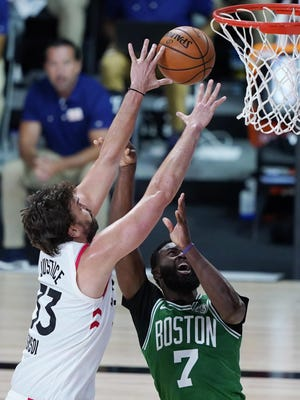 The Raptors' Marc Gasol, left, battles for a rebound with the Celtics' Jaylen Brown during Friday night's game in Lake Buena Vista, Fla. Boston won, 122-100.