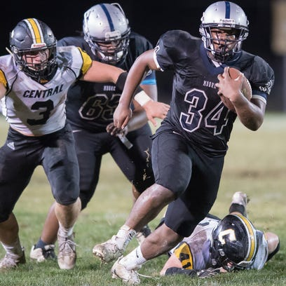 Moore's DeMarion Travis runs for a positive yards during