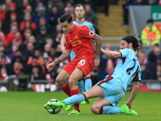Burnley's George Boyd, right, and Liverpool's Philippe Coutinho  battle for the ball during the English Premier League soccer match at Anfield, Liverpool, England, Sunday March 12, 2017. (Peter Byrne/PA via AP)