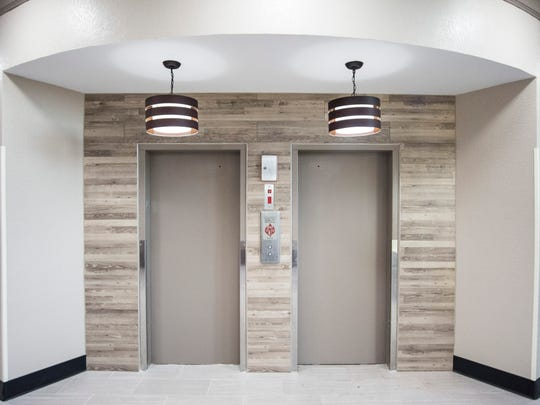 The elevators in the front lobby of the renovated Quality
