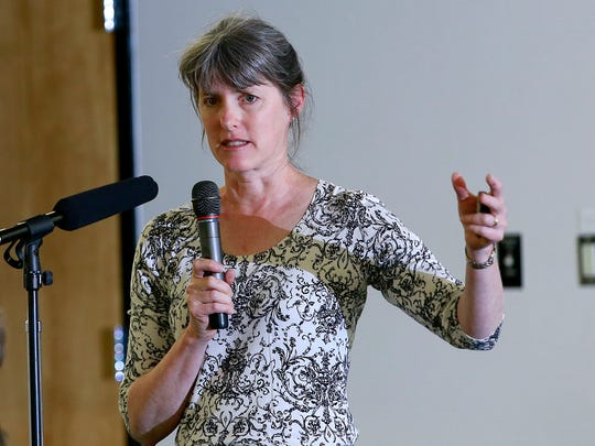Rebecca Thomas, a Superfund project manager with EPA's Region 8, speaks during a public meeting Thursday at the Henderson Fine Arts Center at San Juan College in Farmington.
