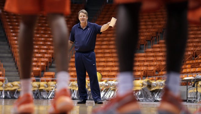 UTEP head basketball coach Tim Floyd puts his players through an intense first practice Thursday at the Don Haskins Center.