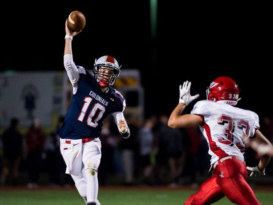 New Oxford's quarterback Brayden Long (10) passes against Bermudian Springs on Friday, September, 1, 2017. The Colonials fell to the Eagles 25-10.