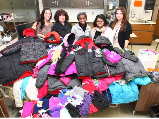 "The Association of Middlesex County College Nursing Students conducted its annual coat drive and delivered 27 coats, 45 pairs of gloves, 28 hats and nine other pieces of winter clothing to the Raritan Bay Medical Center Pediatric Department. The program, called ""Coats for Kids"" is an annual event to aid patients at Raritan Bay. From left: Casey Pinal (Piscataway), secretary; Stacy Horowitz (Monroe Township), treasurer; Moya Stewart-Gray (New Brunswick), vice president; Penninah Menezes (Plainsboro), president; and Luiza Asahme (Iselin), nursing instructor and association advisor."