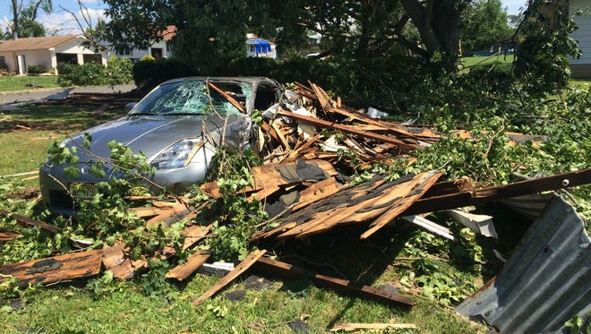 Somers Avenue neighbors say this car acted as a buffer to keep a nearby garage roof from hitting houses in East Greenwich. The car was pushed at least three feet, marks in the dirt show.