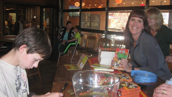"""Local author Pamela K. Witte entertained a large crowd at the release of her book, """"Jet Lee-Dragon Warrior"""" Sunday."""