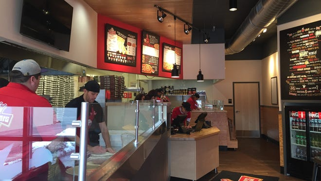 Staff members train inside the new Toppers Pizza that opens Saturday at 817 S. Minnesota Ave.