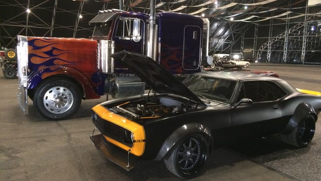 "The stunt cars for Optimus Prime and Bumblebee from the ""Transformers"" movie series are up for auction at Barrett-Jackson in Scottsdale this year."