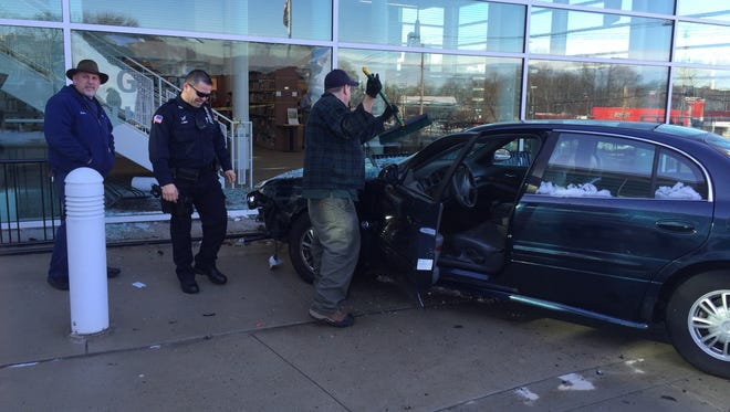 Greenburgh police on the scene after an car crashed into the front window of the Greenburgh public library on Tarrytown Road.