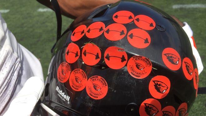 Oregon State wide receiver Victor Bolden displays the Beavers' new-look practice helmets.