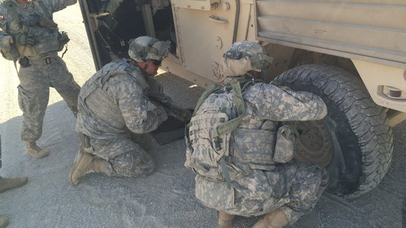 Soldiers from 40th Engineer Battalion fix a flat tire during the Network Integration Evaluation. Lt. Col. Jim Riely, battalion commander, says everything that happens during the exercise serves as a training opportunity.