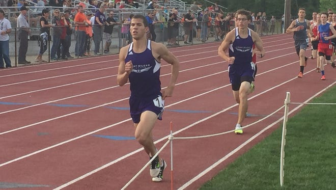 Mount Gilead junior Austin Hallabrin, left, leads teammate Nicholas Weiss during the Blue Division boys 800-meter run at the Mid Ohio Athletic Conference Track Championships Thursday at Mount Gilead.