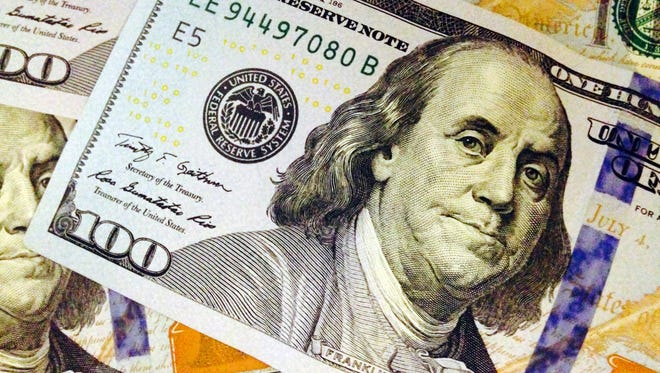 This Feb. 2, 2015, photo depicts a part of a U.S. $100 bill.