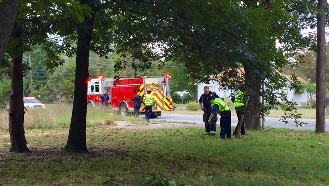 Police investigate at the scene of a fatal collision between a Jeep and bicyclist on Almond Road Tuesday.