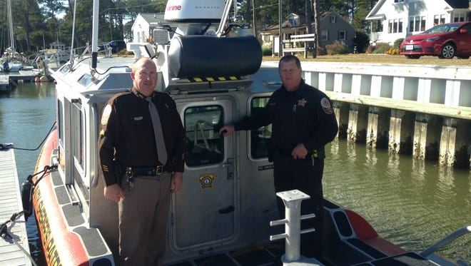Sgt. David Smullin, left, and Deputy Tom Willett of the Accomack County Sheriff's Office are assigned to this 25-foot vessel the Sheriff's Office acquired earlier this year. The boat was used to rescue from the water two victims whose boat capsized in heavy winds on Saturday, Nov. 19, 2016 off East Point near Onancock, Virginia.