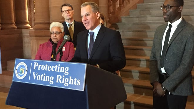 Attorney General Eric Schneiderman discusses proposed reforms to New York's voting laws at a news conference at the state Capitol on Tuesday, Dec. 6, 2016.