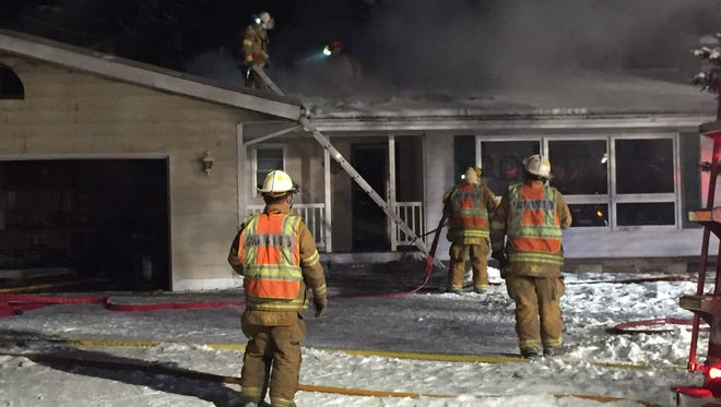 Sauk Rapids firefighters battle a fire Monday night, Dec. 12, at 1109-11th St. N.