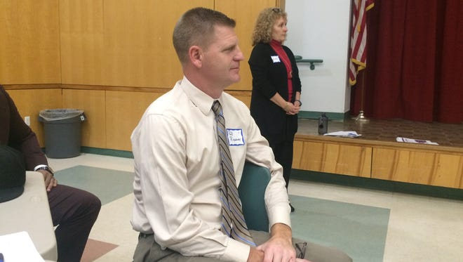 Harper Creek Superintendent Rob Ridgeway attended Thursday's meeting. Lakeview school board President Kathleen Moore stands in the background.
