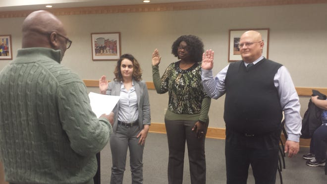 Battle Creek Public Schools Board of Education President Art McClenney, far left, administers the oath of office in 2017 to school board members, from left, Jacqueline Slaby, Kyra Wallace and Eric Jankowski.
