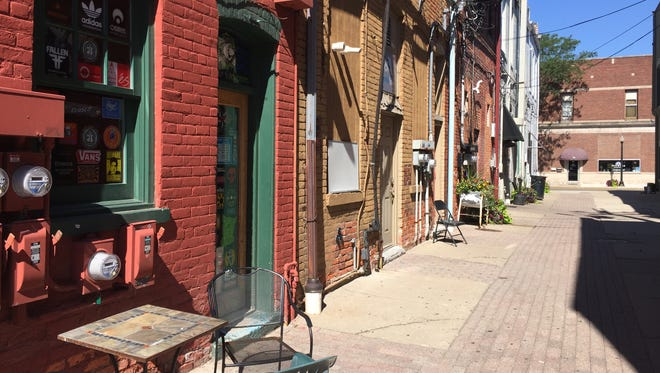 Peanut Row, an alleyway in downtown Howell seen in this photograph taken Wednesday, July 5, 2017, will be transformed into an outdoor hangout and public art gallery.