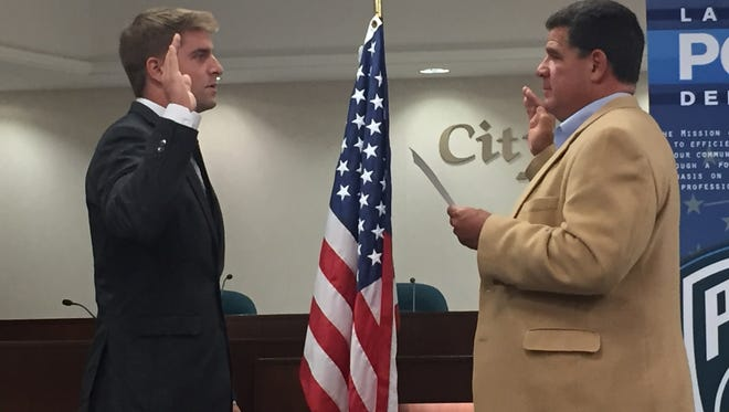 Danny Anthrop, left, is sworn in as a Lafayette Police Department patrol officer by Mayor Tony Roswarski on Friday, Sept. 29, 2017.