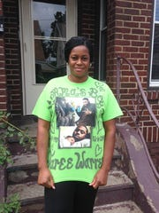 Jennifer Evans outside her Erie home on Tuesday, wearing a shirt honoring her dead son Jaree Warren.