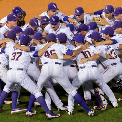 LSU players huddle before a college baseball game against