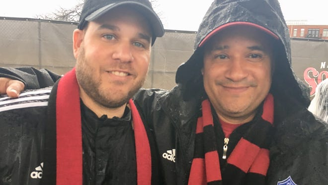 Atlanta United fans Miguel Miranda and Lawrence Garcia  drove from Atlanta to watch their team play Nashville SC in the rain in an exhibition Saturday at First Tennessee Park.