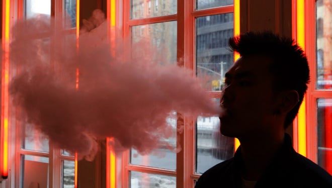 The Federal Aviation Administration is warning airlines about the possible fire hazard from e-cigarettes packed in checked luggage.