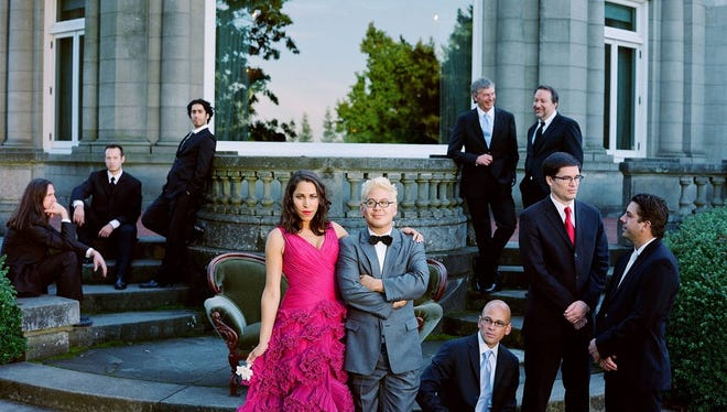 Frontwoman China Forbes and founder Thomas Lauderdale (middle) lead Portland-based Pink Martini.