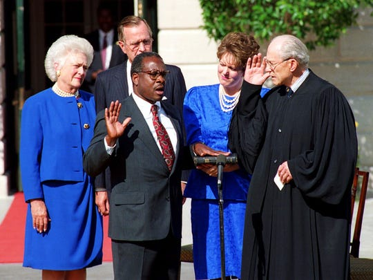 Clarence Thomas is sworn into the Supreme Court by Justice Byron White in October 1991.