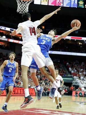 Grayson Allen of the Duke Blue Devils shoots the ball against Louisville.
