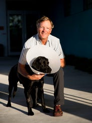 Donald Copps and his friend's 4-year-old black Lab,