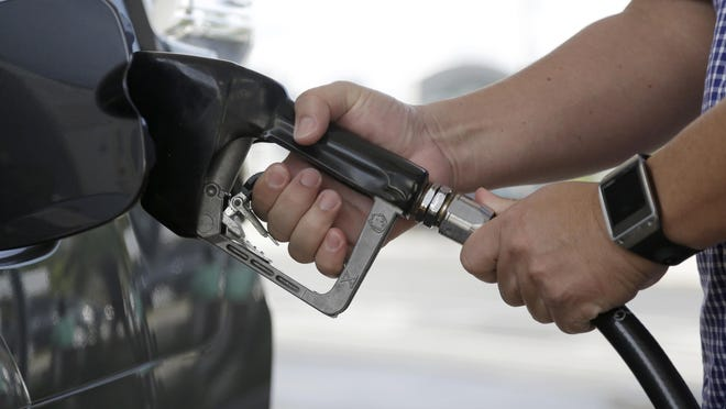 AP A motorist puts fuel in his vehicle at a Westar gas station, Friday, Jan. 23, 2015, in Miami. For the first time since 2009, most Americans are paying less than $2 a gallon. Just three months ago experts were shocked when it fell under $3. (AP Photo/Lynne Sladky) ORG XMIT: FLLS103