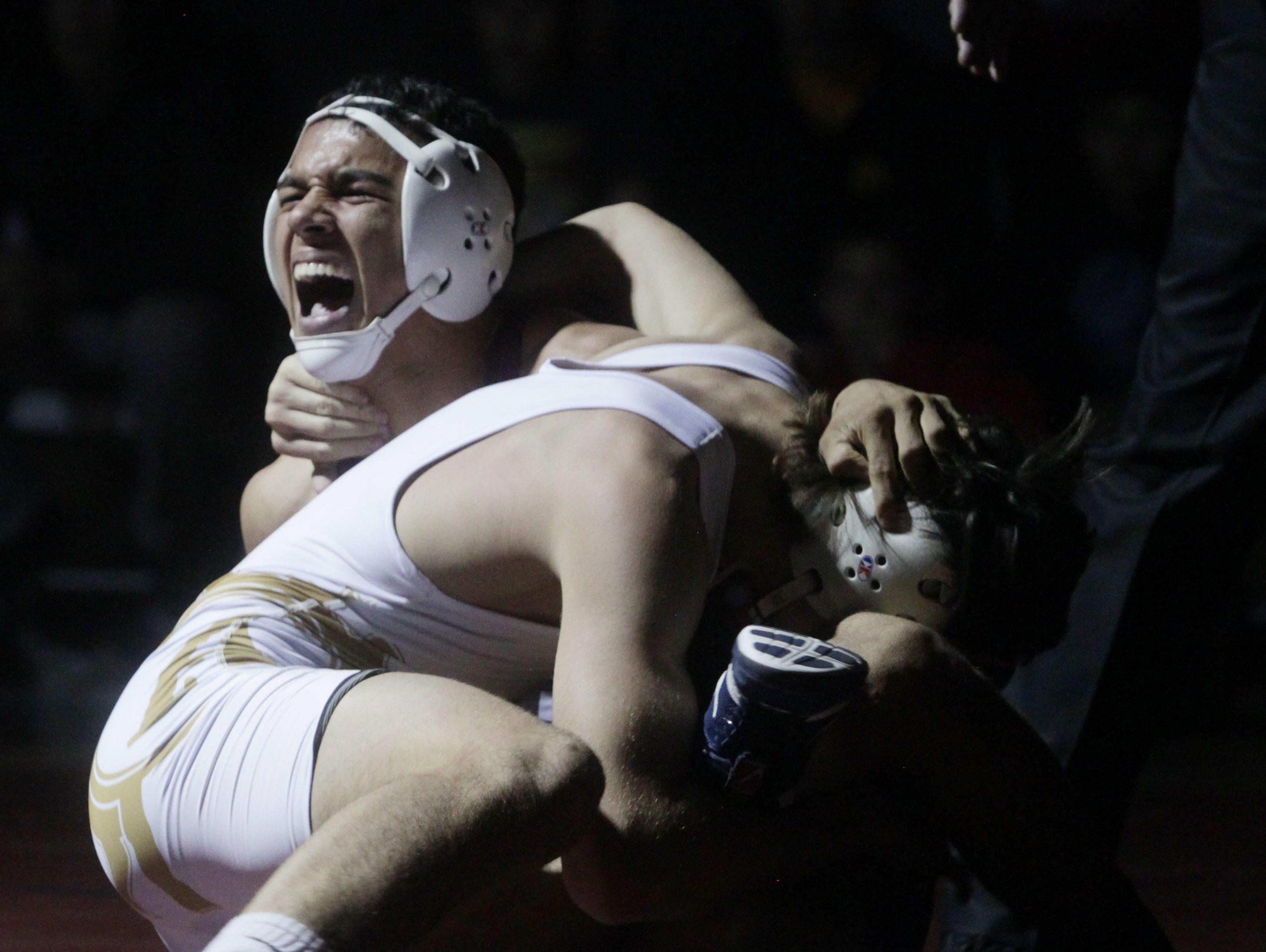 Wrestler of Palm Desert High School Troy Mantanona, in white uniform goes against Jacob Arrellano of La Quinta at La Quinta High School on January 27, 2016.