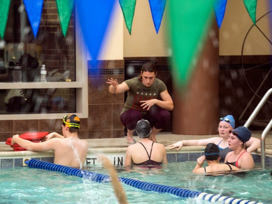 New Oxford head coach Tasha Christie talks to the Colonials swim team, Dec. 07, 2018. The New Oxford swim team uses the wellness center pool at Cross Keys Village as their practice pool, utilizing the pool from 5 a.m. to 7 a.m.