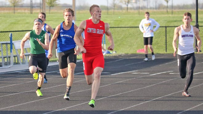 Grant Mason (in red) runs in the Johnson County meet.