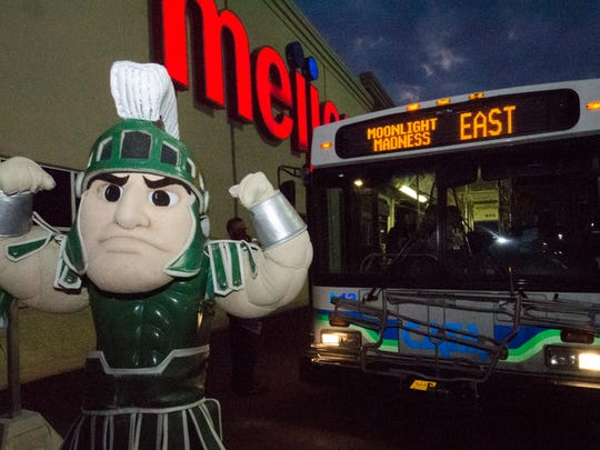 """Sparty makes an appearance during a """"Moonlight Madness"""" back-to-school event at Meijer in East Lansing. This year's event is set for Monday, Aug. 28."""