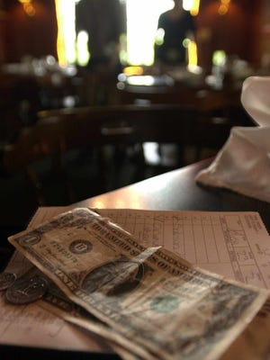 Busboys and bartenders get tipped out by servers at restaurants.