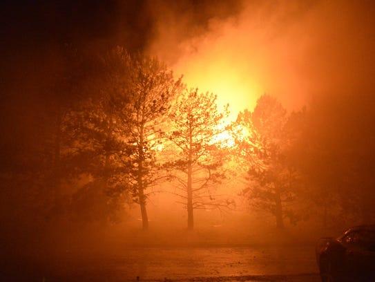 Henrietta firefighters extinguish a fire at an apartment