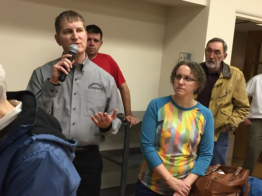 Phil Wolgemuth, assistant to Chambersburg's Borough Manager, answers questions at Thursday's curb and sidewalk committee meeting.
