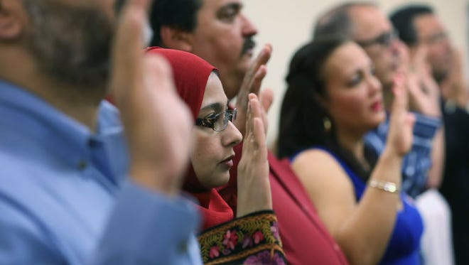 Indian immigrant at a naturalization ceremony in Florida on February 14, 2013.