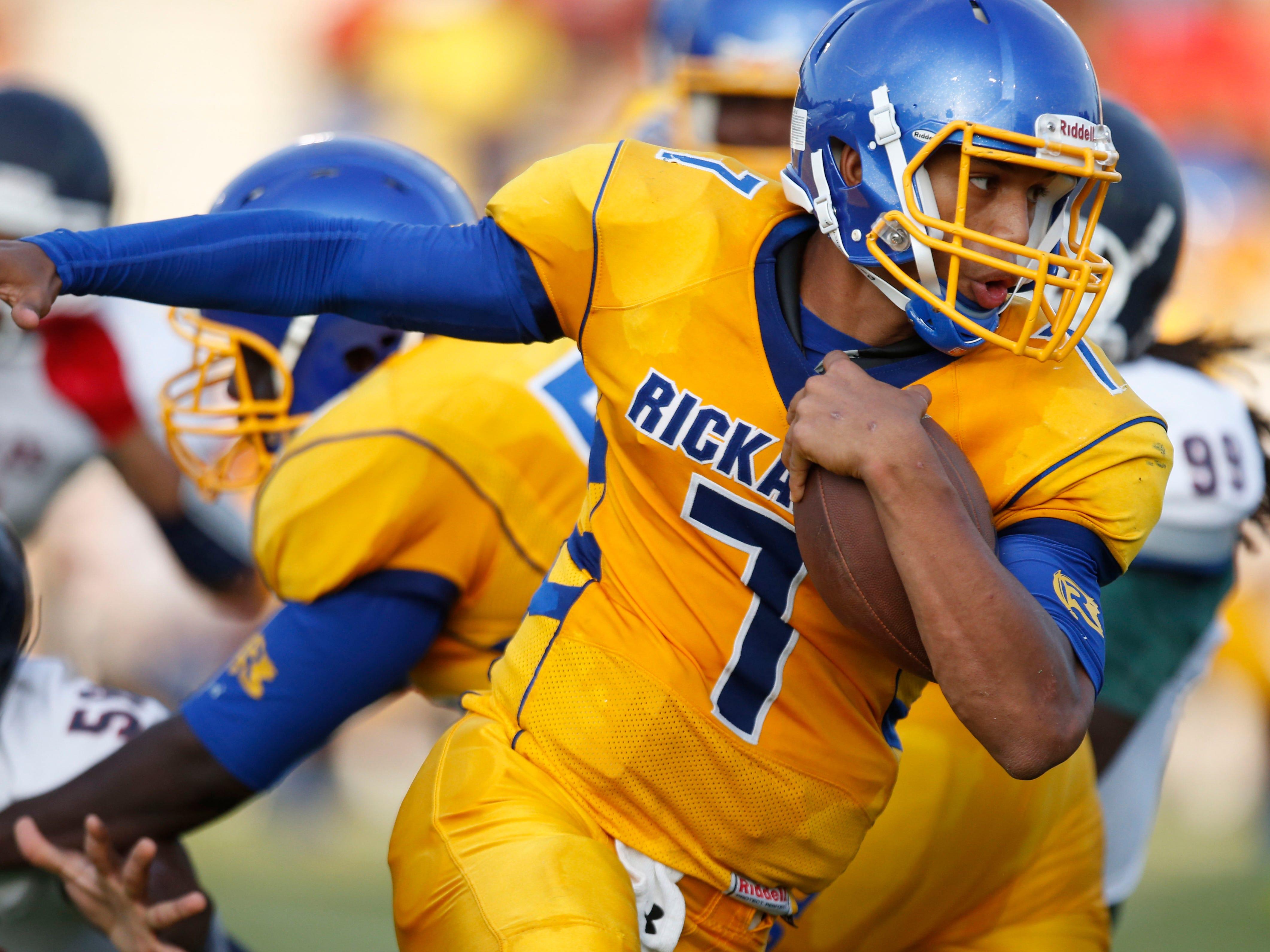 Rickards quarterback DJ Phillips runs the ball against Wakulla during a jamboree at Gene Cox Stadium on Thursday.