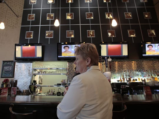 Kris Hruska from Canton, waits at the bar for gift cards on Thursday, Dec. 18, 2014 at Hayden's Restaurant in Canton. Tim Galloway/Special for DFP