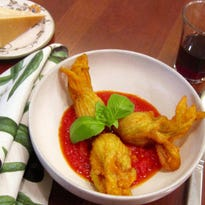 This dish of stuffed zucchini blossoms is from a recipe by Sara Moulton.
